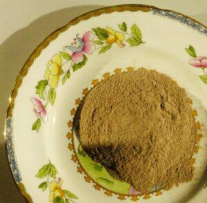 Rhassoul clay powder on a plate.