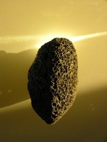 A blackvolcanic pumice stone