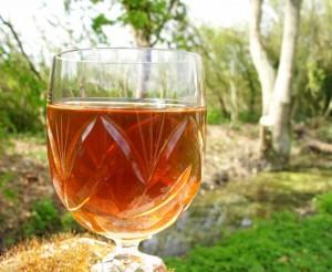 a glass of dandelion wine